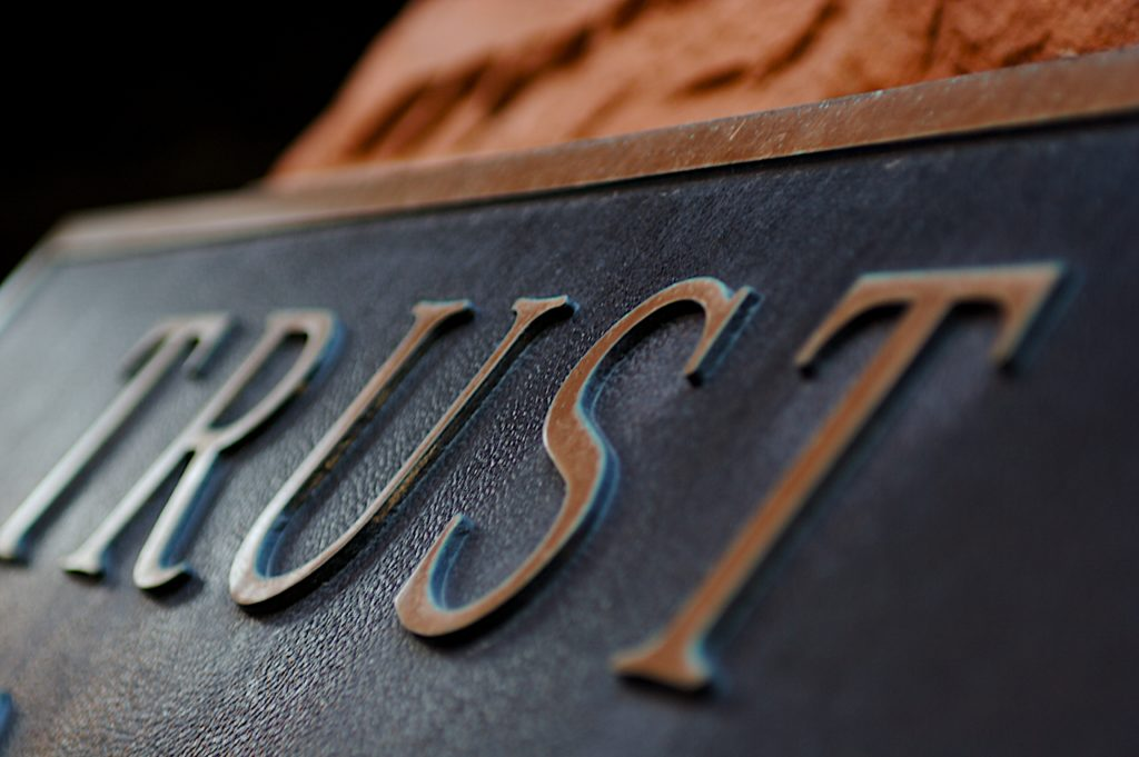 Image of a plaque with trust written
