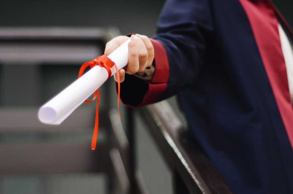 Image of person holding white scroll