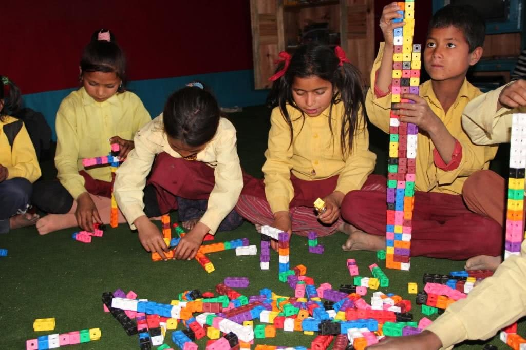 Image of kids in Nepal playing with blocks