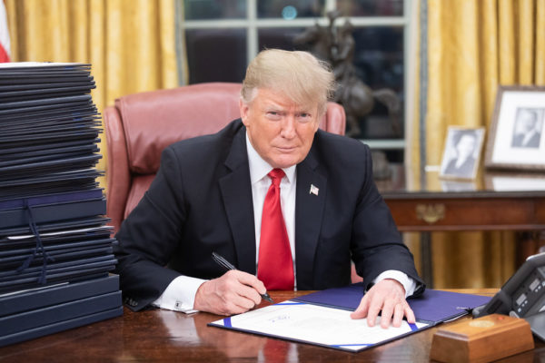 Image of President Trump at Oval Office Desk